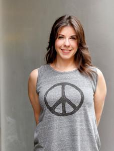 Dana Pitman wearing a gray peace symbol shirt
